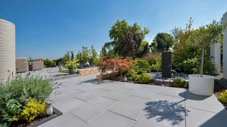 Die Terrassenplatten Madison und Andalusia von KANN sind mit dem CleanKeeper plus Oberflächenschutz ausgestattet.